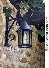 The old lantern on old brick wall