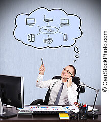 computer network - young businessman sitting in office and...