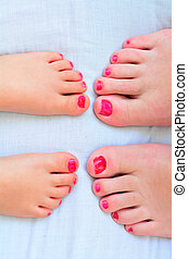 Mother and child paint their feet with nail polish - Young...