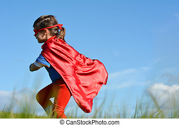 Superhero child - girl power - Superhero child (girl) runs...