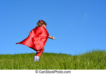 Superhero child - girl power - Superhero child girl runs in...