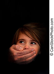 Human trafficking - Concept Photo - Strong male hands cover...