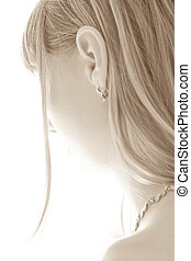 young girl\'s sepia portrait from behind