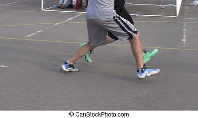 Basketball Players on the Court - Competition among...