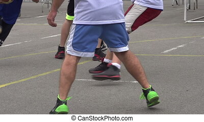 Basketball Player Attacking - Competition among...
