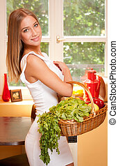 Basket of healthy diet - Fit gorgeous young blond woman...