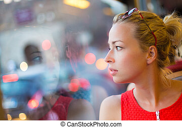 Woman looking out trams window - Thoughtful lady riding on a...