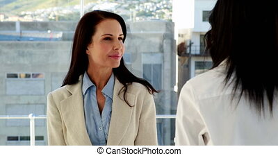 Businesswoman smiling and chatting - Pretty businesswoman...