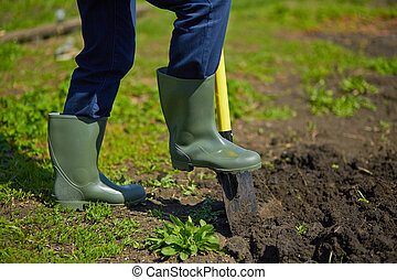 Digging - Image of male farmer digging in the garden