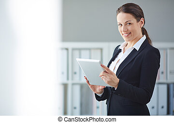 Businesswoman with touchpad - Young businesswoman with...