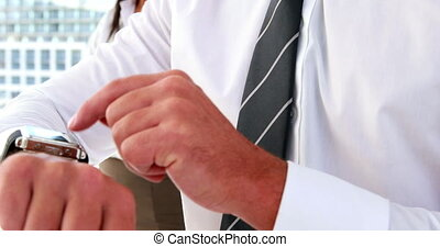 Businessman using his smart watch in the office