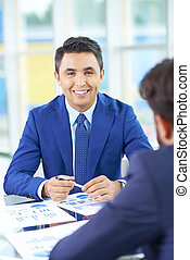 Successful employer - Image of handsome businessman looking...