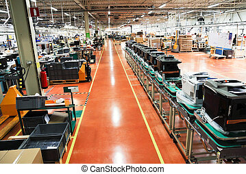 production conveyor of office devices on factory