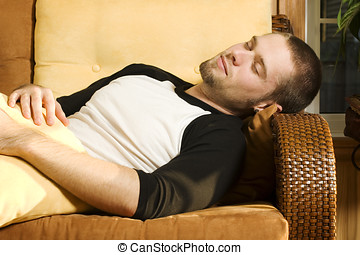 Young man taking a nap on couch