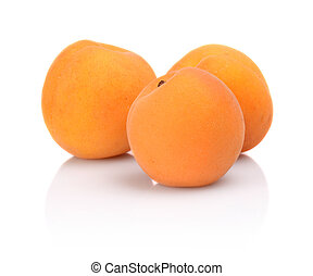 Three whole apricots isolated on white background