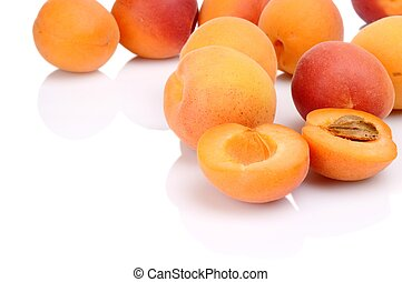 Several sliced apricots isolated on white - Many sliced...
