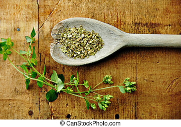 Oregano Sprig with Dried on a Wood Table - Oregano sprig...