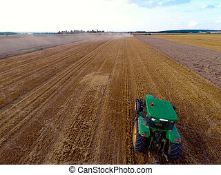 Tractor on field in bird-eye view - Bird-eye view of tractor...