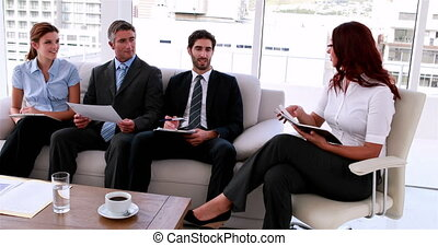 Business team sitting on couch