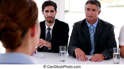 Interview panel speaking to applicant in the office