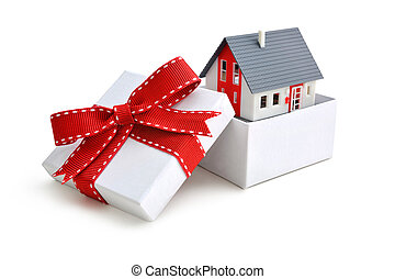 house in gift box - Model of a house in gift box with red...