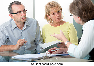 Financial advice - Couple getting financial advice from...
