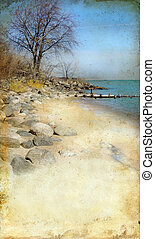 Rocky Beach on Grunge Background - Rocky beach in winter on...