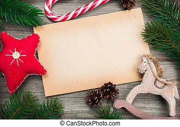 Christmas background with festive decoration over wooden...