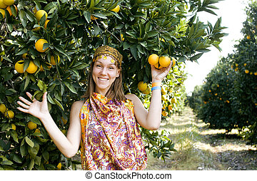 pretty woman in orange grove smiling - pretty islam woman in...