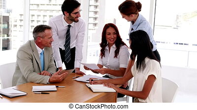 Business people sealing a deal during meeting in the office