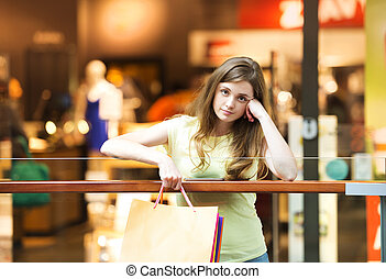 Tired girl in shopping centre - Girl in the shopping centre...