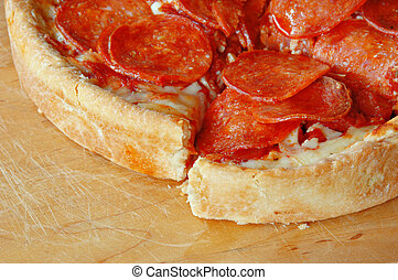 Deep Dish Pepperoni Pizza - Sliced deep dish pepperoni pizza...