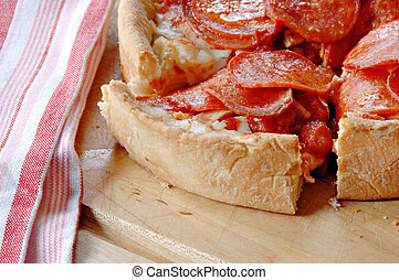Deep Dish Pepperoni Pizza - Deep dish pepperoni pizza with a...