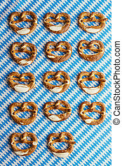 Oktoberfest: Pretzels on bavarian tablecloth - Group of...