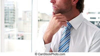 Businessman thinking and looking ou - Handsome businessman...