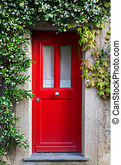Red Entrance Door with jasmine flowers - Close up of a red...