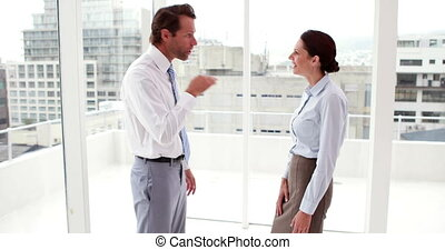 Business team arguing by window - Business team arguing by...