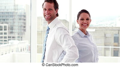 Business colleagues smiling at came - Confident business...