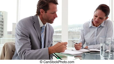Business people working together at desk in the office