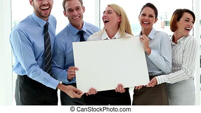 Business team showing a white card - Happy business team...