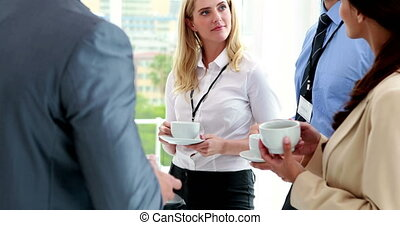Business people at conference - Business people standing at...
