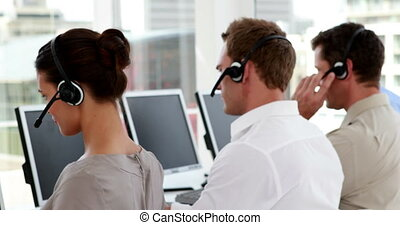 Call center employees at work in the office