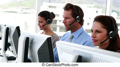Happy call center employees at work in the office
