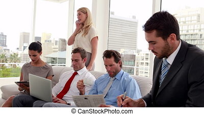 Business team sitting in staff room in the office