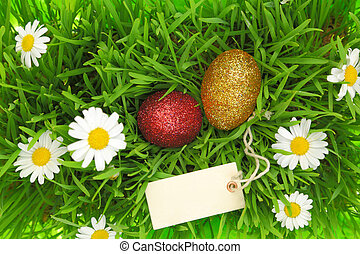 Green grass with Easter glittering eggs and label
