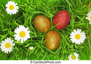 Easter background with grass, flowers and colorful glitter...
