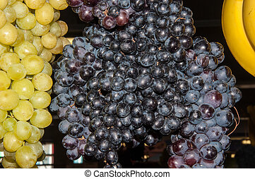 Selling grapes on the market - Grapes are a genus of plants...