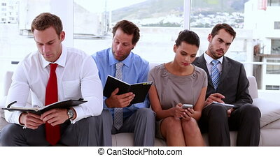 Business people waiting to be called into interview in the...