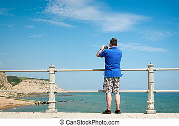 Photographer at Hastings - An image of a photographer at...