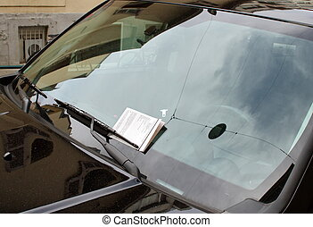 Swiss parking ticket on motor car windscreen or windshield